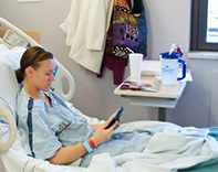 Patient in hospital bed - credit Kristin Klein