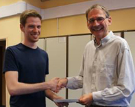 Benno Simmons (left) receiving his award from Dr Nick Mundy