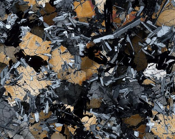 A basalt lava collected by Apollo 11, seen in microscope thin section with polarised light. Image by NASA / Andy Tindle