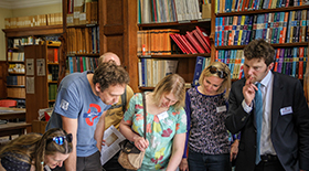 Alumni Day 2016, alumni viewing maps in the Library