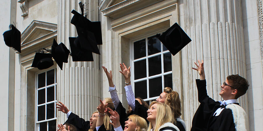 New graduates throwing mortarboards