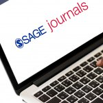 SAGE Journals logo on laptop