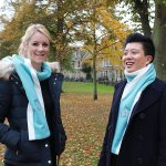 Models wearing the alumni scarf with fleece