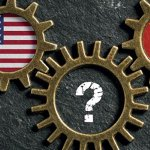 Three interlocking cogs with flags inside, including USA and Russia