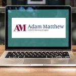Laptop with Adam Matthew logo on the screen