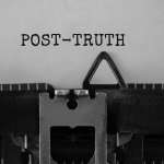 Typewriter with the word 'Post-truth' typed