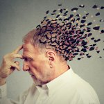 Memory loss due to dementia. Senior man losing parts of head as symbol of decreased mind function