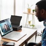 Man at home talking to woman via Zoom