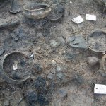Burnt whole pots and fire-damaged debris from the Bronze Age settlement at Must Farm