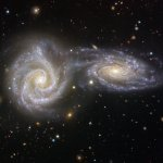 image of two spiral galaxies