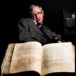 image of Stephen Hawking with a book from archive