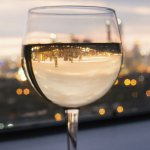 White wine glass with city view