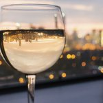 Wine glass with city view