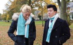 Alumni modelling the scarf with fleece