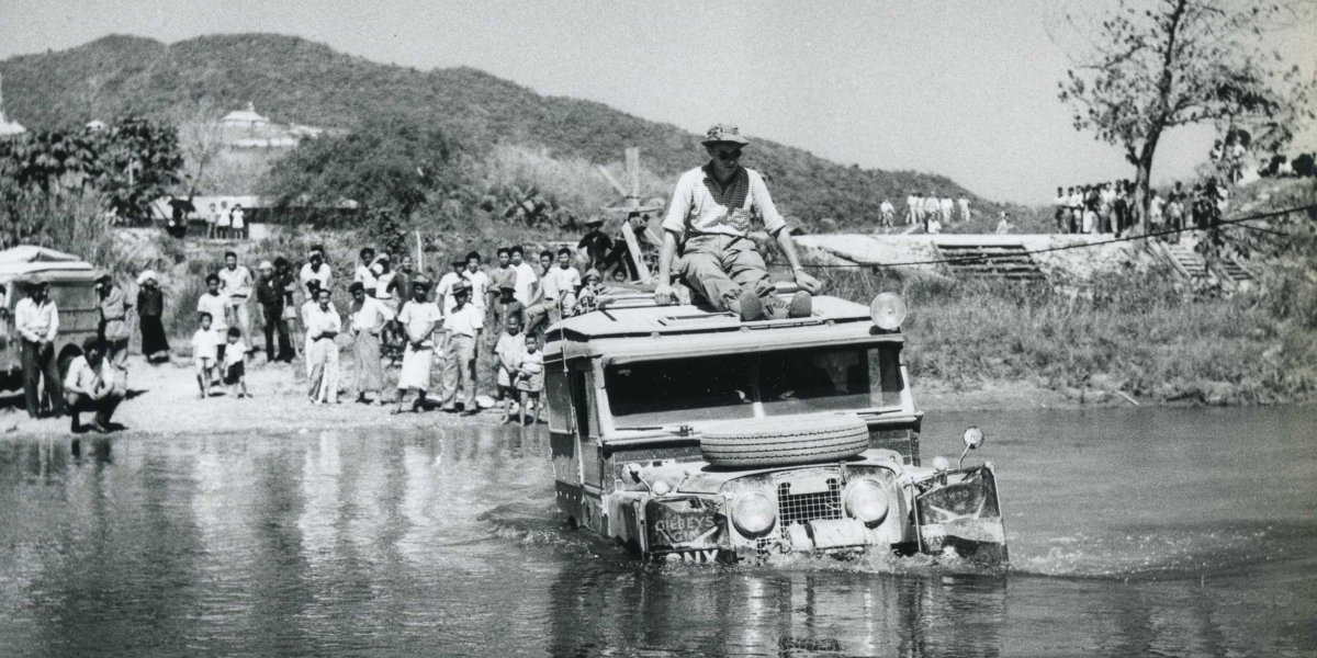 Photo from the first expedition: Tim Slessor sits on top of a landrover fording the Mesai River, Burma (Myanmar)