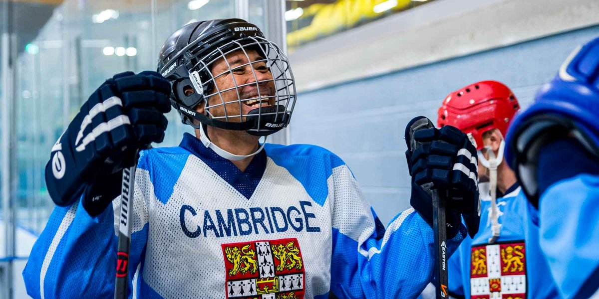 Smilling ice hockey player in Cambridge uniform