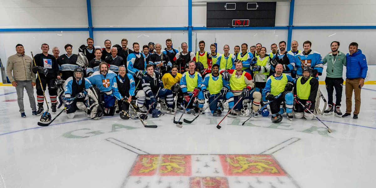 Group photo on the ice with teams in uniform