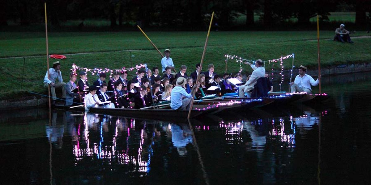 Singing on punts on the river in May Week