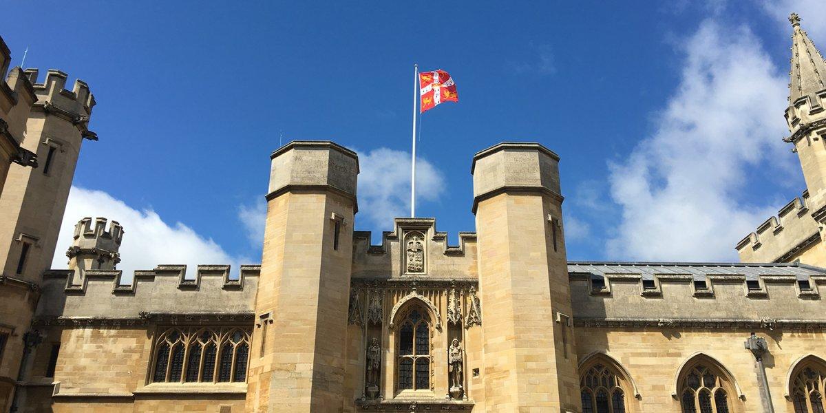 University flag flying above Old Schools