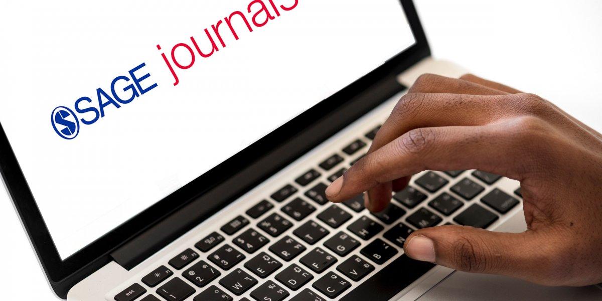 SAGE Journals logo on laptop