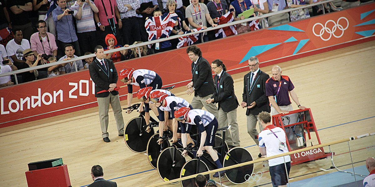 Four cyclists at the start line in the velodrome at the London 2012 Olympics. Photo by Simon Connellan on Unsplash.