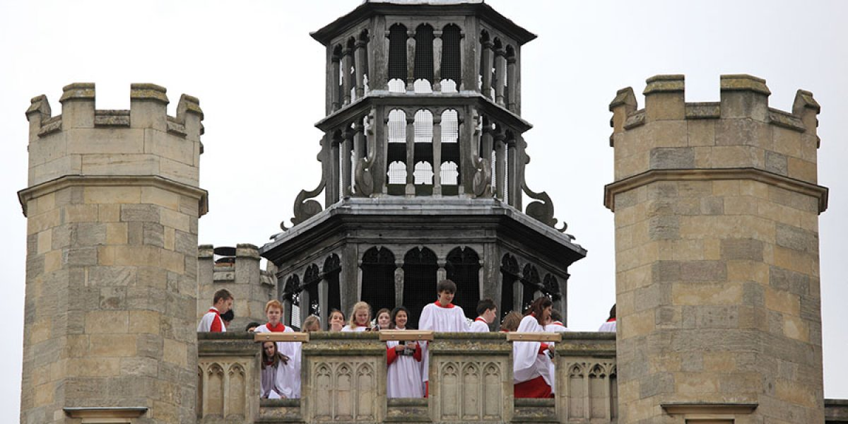 Choir singing from Trinity College's tower