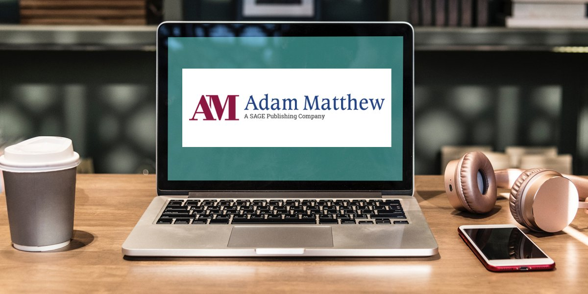 Laptop with Adam Matthew logo on the screen