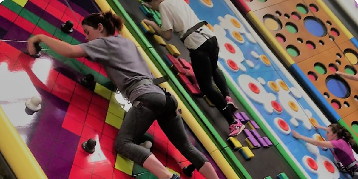 Girls climbing a wall