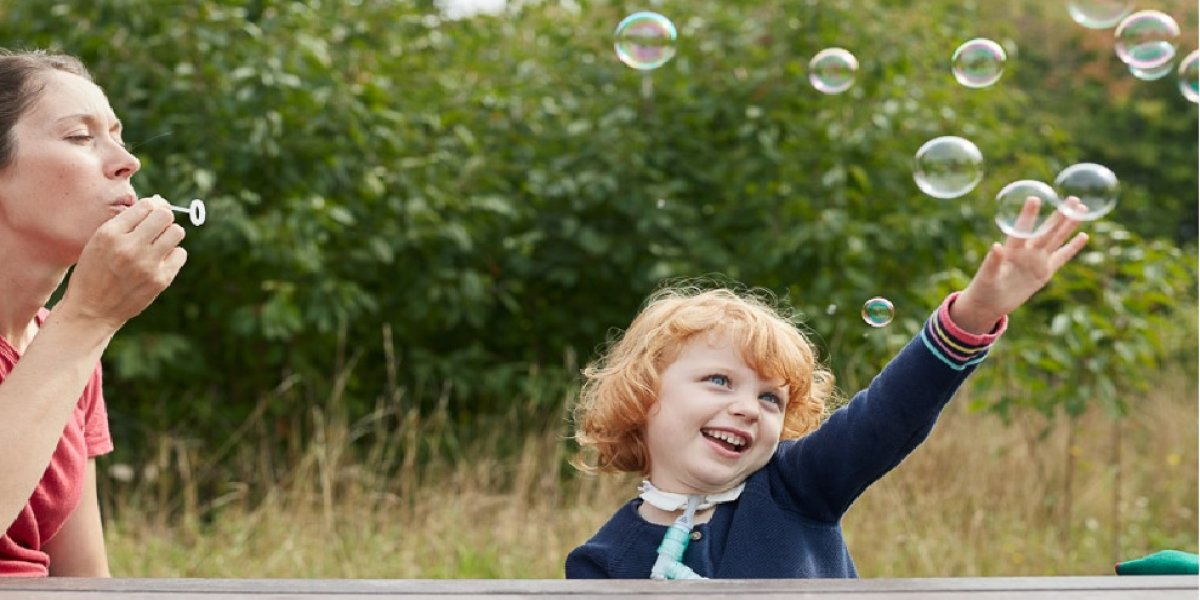 Image of child playing with bubbles