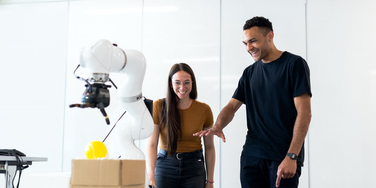 two people working with AI