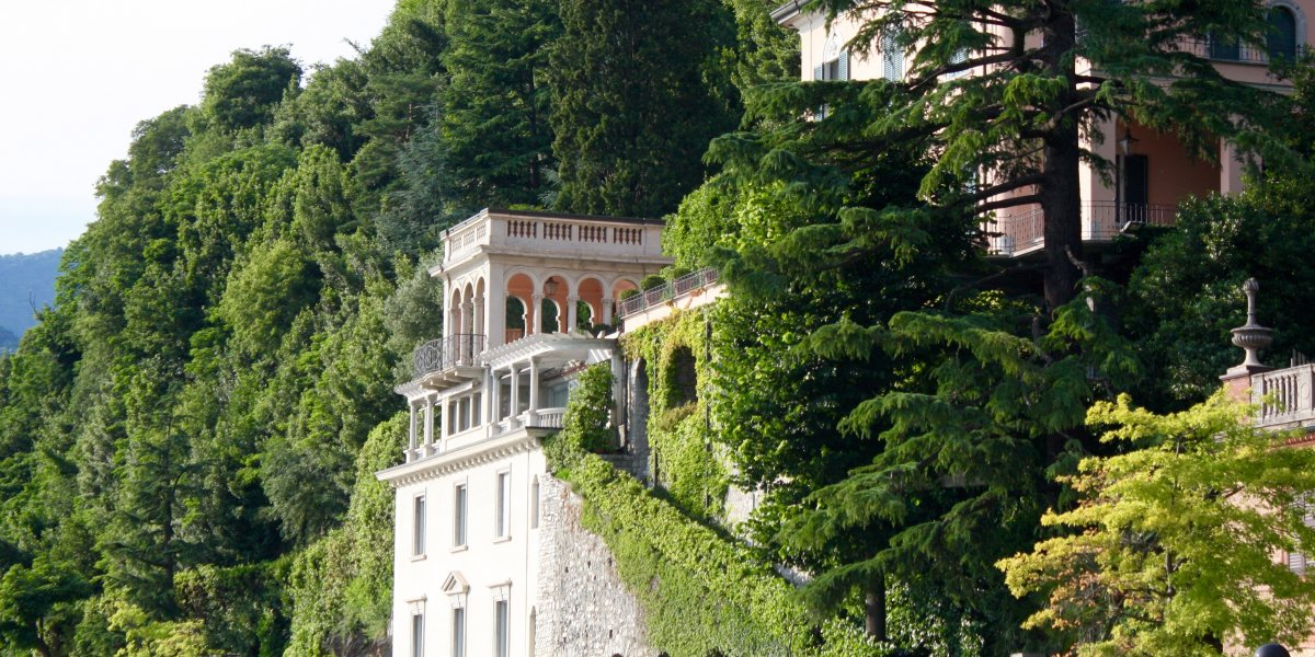 image of an Italian building with plants growing around it