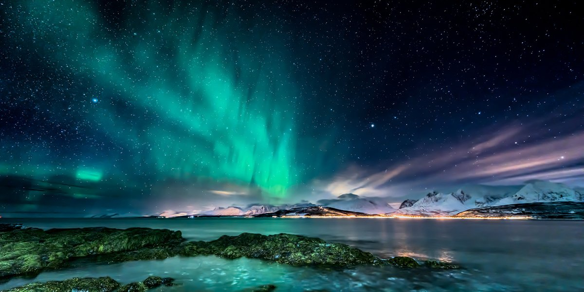 Amazing aurora borealis - northern lights - view from coast in Oldervik, near Tromso city