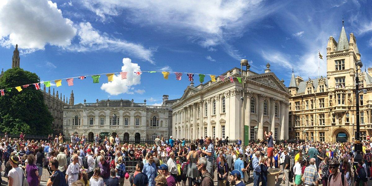 Crowds alongside the 2014 Tour de France course through Cambridge, past Senate House and King's College.