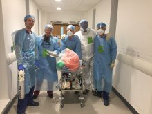 Dr Ivan Wong and team in full medical PPE