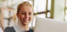 Smiling girl looking at computer