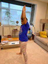 8 year old daughter doing some of her PE lesson via cosmic kids yoga on You Tube