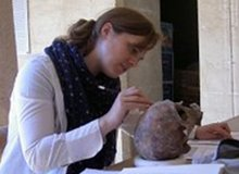 Dr Sarah Inskip collecting data from a human skull